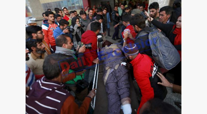 An injured in a grenade attack by the militants in Sopore being shifted to Srinagar's SMHS Hospital on Monday. —Excelsior/Shakeel