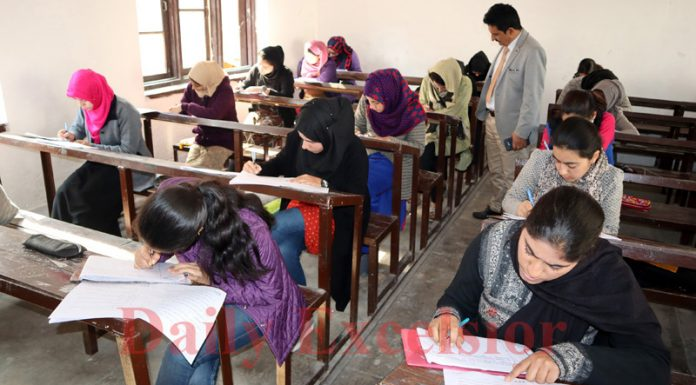 Students of Class 12th appearing for their annual exams in Srinagar on Wednesday. —Excelsior/Shakeel