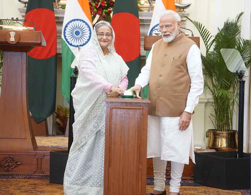 Prime Minister Narendra Modi with his Bangladesh counterpart Sheikh Hasina inaugurating various bilateral projects during their meeting at Hyderabad House, in New Delhi on Saturday. (UNI)