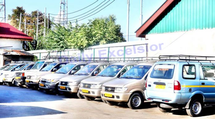 With no work, vehicles parked in a Srinagar area. -Excelsior/Shakeel
