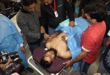 A civilian injured in grenade attack being taken to hospital in Srinagar on Saturday. -Excelsior/Shakeel