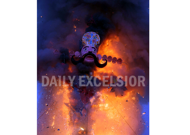 The effigy of demon King Ravan in flames during Dussehra celebrations at Parade Ground, Jammu on Tuesday. -Excelsior/Rakesh