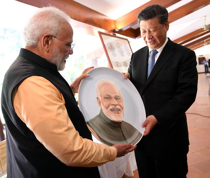 Prime Minister Narendra Modi exchanging the gifts with President of the People's Republic of China Xi Jinping in Mamallapuram, Tamil Nadu on Saturday. (UNI)