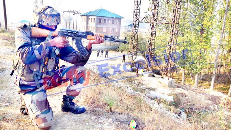 An Army soldier takes position during encounter with militants at Bijbehara, Anantnag on Wednesday. -Excelsior/Sajad Dar