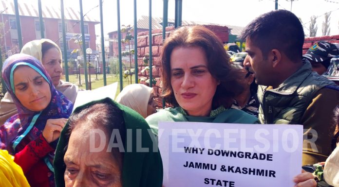 Women protest over abrogation of Article 370 in Srinagar on Tuesday. -Excelsior/Shakeel