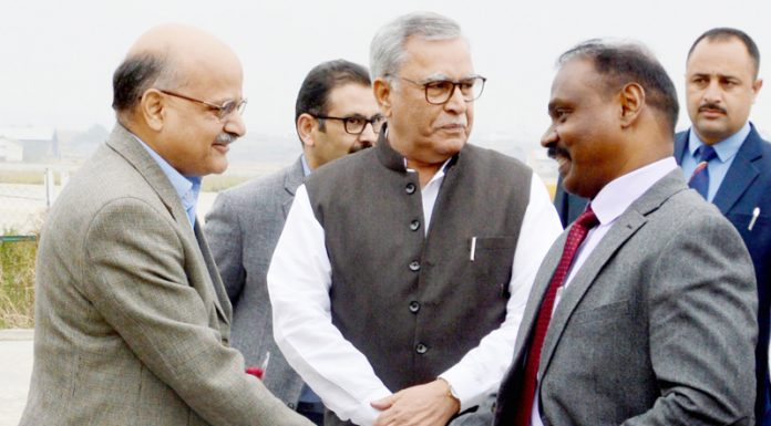 Girish Chandra Murmu being received at Srinagar by Farooq Khan and BVR Subrahmanyam on Wednesday.