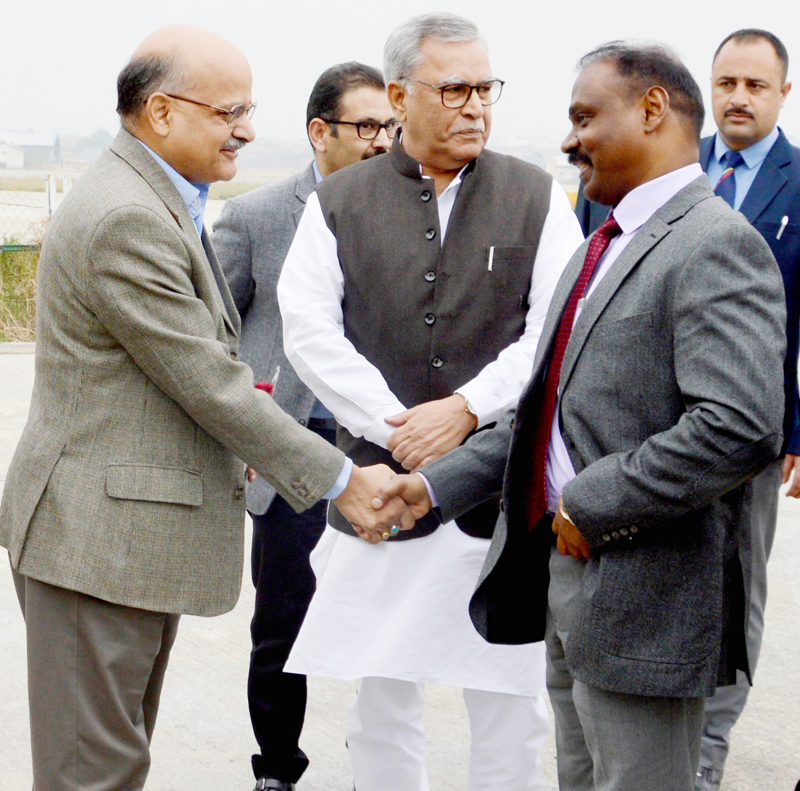 Girish Chandra Murmu being received at Srinagar by Farooq Khan and BVR Subrahmanyam on Wednesday.