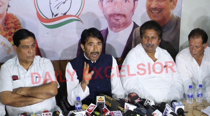 PCC chief GA Mir, flanked by senior leaders, Raman Bhalla and Ravinder Sharma, addressing a press conference in Jammu on Wednesday. —Excelsior/Rakesh