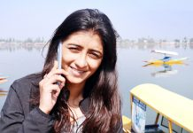 A woman speaks on mobile phone in Srinagar on Monday. -Excelsior/ Shakeel