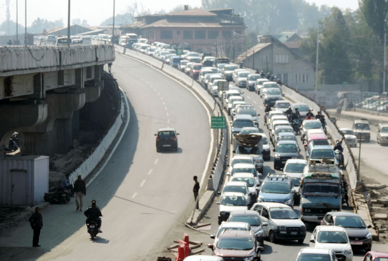 A carvan of private vehicles crossing Rambagh flyover in Srinagar on Monday. (UNI)