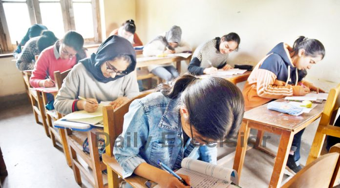 Students sit in exam for Class X at a school in Srinagar on Tuesday. -Excelsior/Shakeel