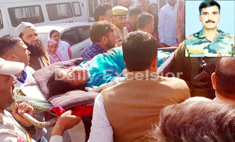 A woman injured in Pak shelling being taken to hospital and (Inset) Martyr Valte Sunil Ravsaheb. -Excelsior/Rahi Kapoor