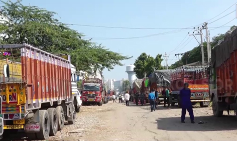 Empty trucks, which returned from Kashmir after attacks, parked at Narwal Fruit Mandi in Jammu. — Excelsior/Rakesh