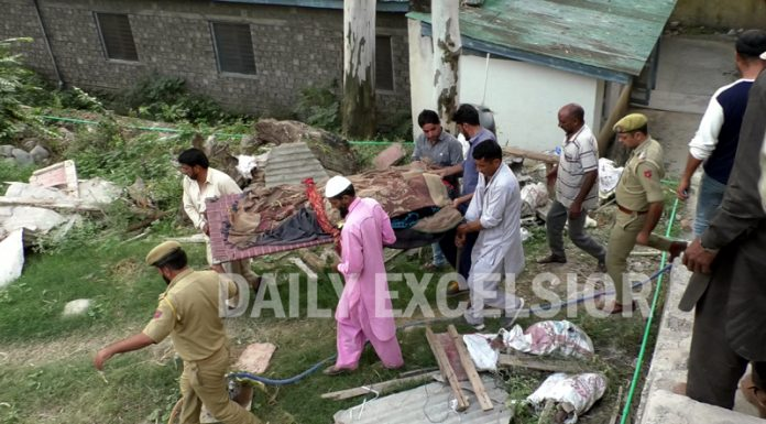 A shelling victim being taken to hospital in Poonch on Tuesday. -Excelsior/Gurjeetbhajan