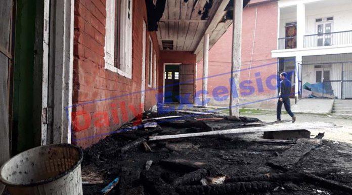 Govt Middle School set ablaze at Watoo, Kulgam. -Excelsior/Sajad Dar