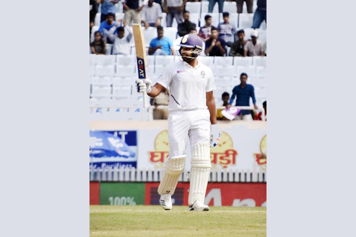 Rohit Sharma raises his bat after scoring 150 against South Africa during the second day of the third and final Test match between India and South Africa in Ranchi on Sunday.(UNI)