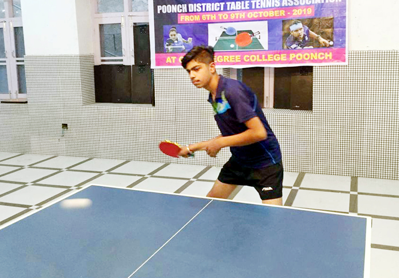 Ridhik Kapoor in action during the Sub-Junior boys' final at GDC Indoor Hall in Poonch on Tuesday.