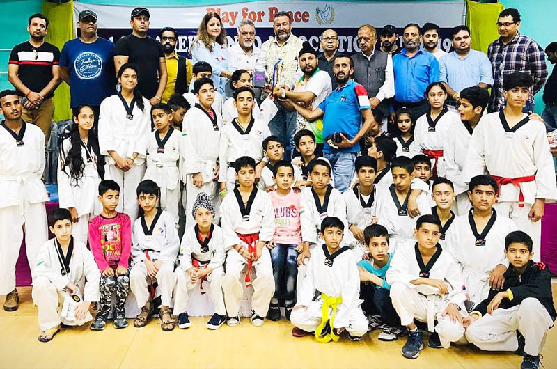 Meritorious District Poonch Taekwondo team posing for a group photograph during its reception at Poonch.