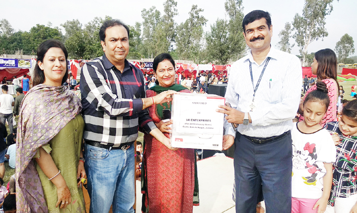 Gift presentation during Diwali Mela organised by G D Goenka School in Jammu.