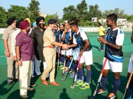Chief guest interacting with players during 'Sarbat Da Bhalaa' Hockey Tournament at KK Hakhu Astroturf Hockey Stadium in Jammu.
