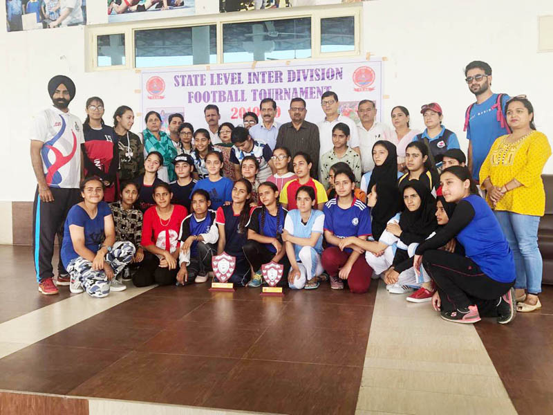 Young footballers posing along with chief guest, Ashok Kumar and other dignitaries at SMVDSB Sports Complex, Katra.