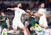 Italy's Ciro Immobile (R front) vies with Greece's Dimitri Siovas (L) during the UEFA Euro 2020 qualifier Group J soccer match between Italy and Greece in Rome.