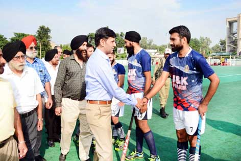 Chief guest interacting with players during the inaugural ceremony of Hockey Tournament in Jammu.