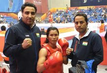 Poonam posing along with her coaches Kuldeep Handoo and Rajesh Kumar Tailor.