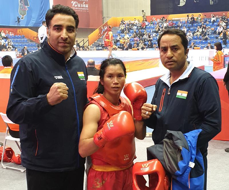 Poonam posing along with her coaches Kuldeep Handoo and Rajesh Kumar Tailor.