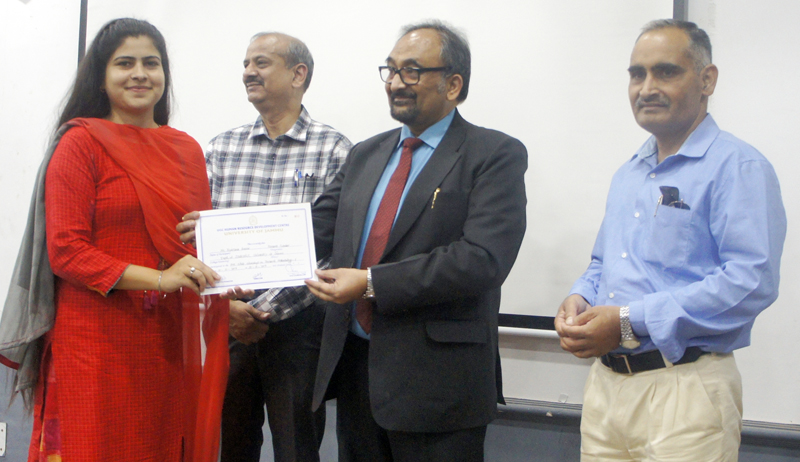 One of the participants being presented certificate during valedictory function of week-long workshop at JU.