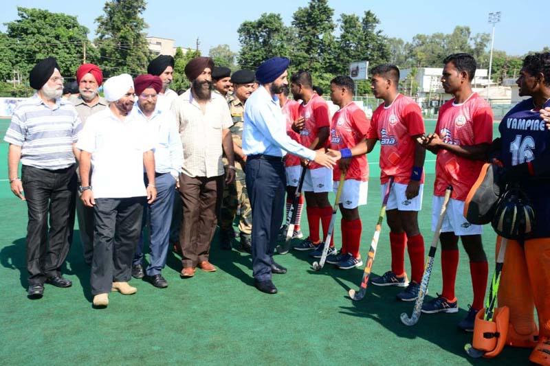 Chief guest interacting with players during 'Sarbat Da Bhalaa' Hockey Tournament in Jammu.