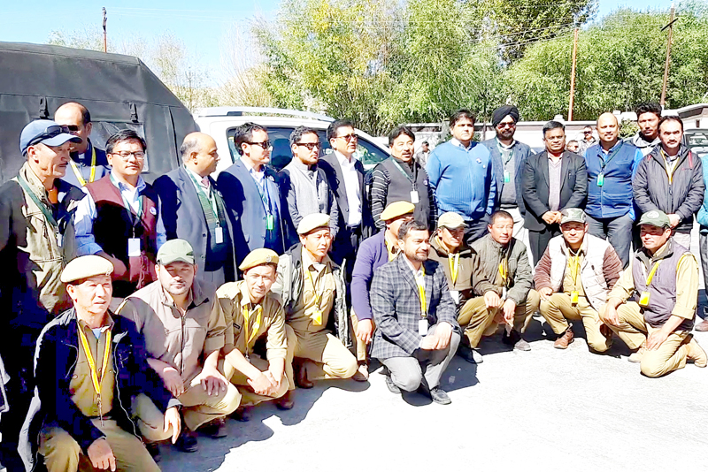 Dignitaries posing for group photo in front of the wildlife animal rescue and antipoaching vehicles. -Excelsior/Morup Stanzin