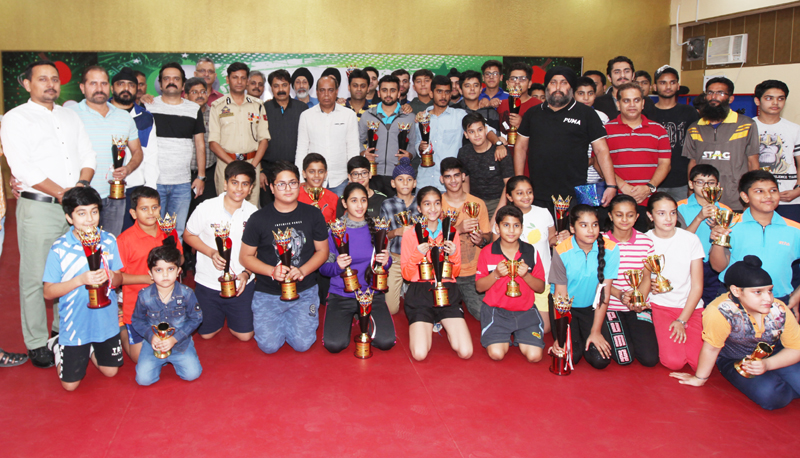 Winners posing along with IGP Jammu, Mukesh Singh and other dignitaries during closing ceremony of 42nd Stag J&K TT Championship in Jammu.