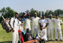 Players of Satisar CC posing for a group photograph before leaving for Gurgaon.