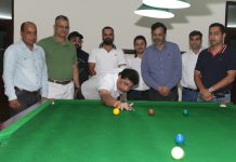 Siddarth Sharma, Chairman JKBSA aiming at target while inaugurating Snooker Championship in Jammu. —Excelsior/Rakesh