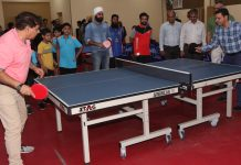 Div Com Sanjeev Verma testing his TT skills while inaugurating State Championship in Jammu on Friday. —Excelsior/Rakesh