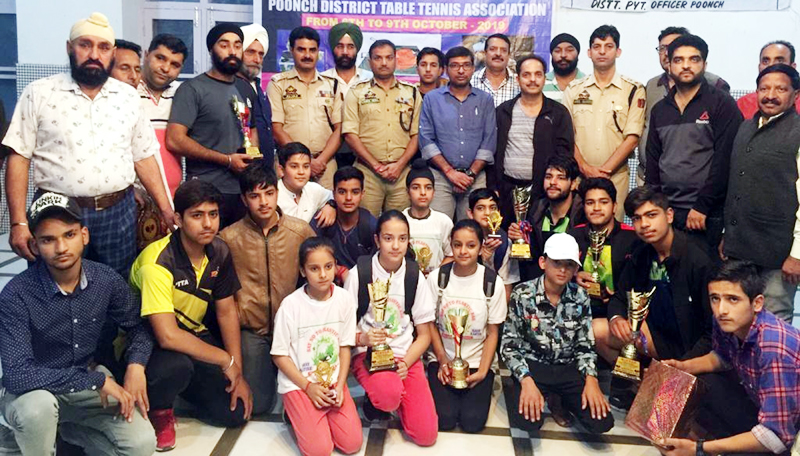 Medal winners of 29th Poonch District TT Championship posing along with dignitaries and officials on Thursday.