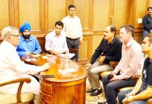 Advisor Farooq Khan interacting with a delegation on Monday.