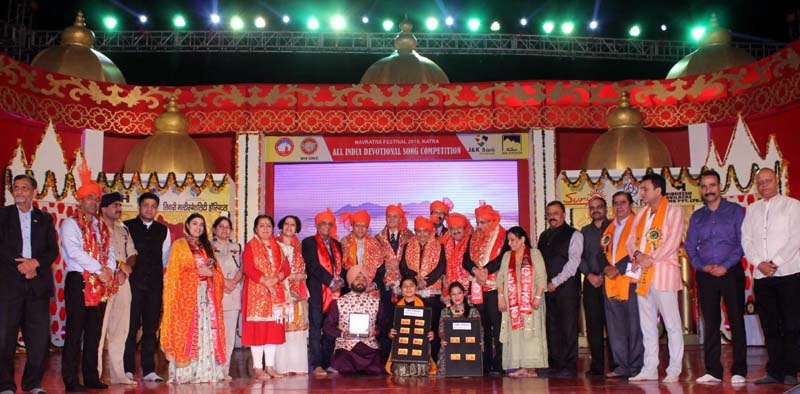 Winners of All India Devotional Song Competition posing with dignitaries.