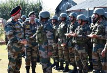 GOC-in-C Northern Command Lt Gen Ranbir Singh interacting with troops in Valley on Thursday.