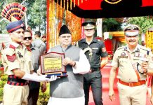 Governor Satya Pal Malik awarding a recruit during 26th BRTC passing out parade at S. Prithinandan Singh Police Training School Kathua on Monday.