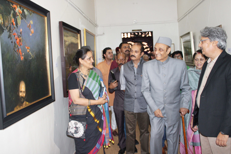 Dr Karan Singh and others inspecting art works on display at Amar Mahal Museum. —Excelsior/Rakesh