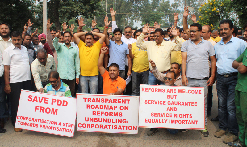 PDD employees staging protest near Div Com office in Jammu on Thursday. —Excelsior/Rakesh