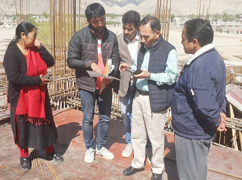 A JKPCC official apprising Justice Tashi Rabstan of construction work of Guest House in Court Complex, Leh.