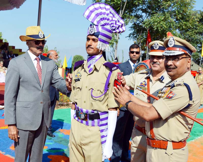 Advisor Vijay Kumar decorating best performing trainee during Attestation-cum-Passing out parade on Thursday.
