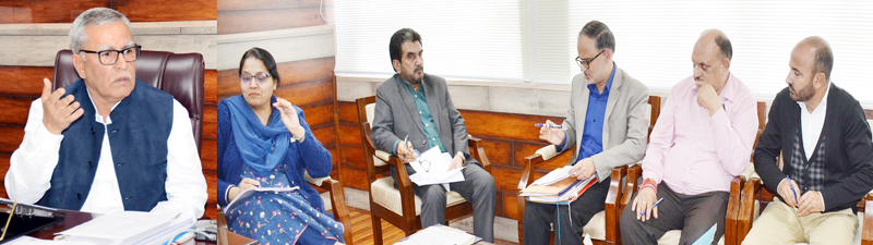 Advisor Farooq Khan chairing a meeting on Wednesday.