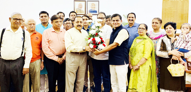 Union Minister Dr Jitendra Singh being felicitated by a delegation of Pak occupied Jammu & Kashmir (PoJK) Displaced Persons for the Union Cabinet's decision regarding Rehabilitation Package, at New Delhi on Thursday.