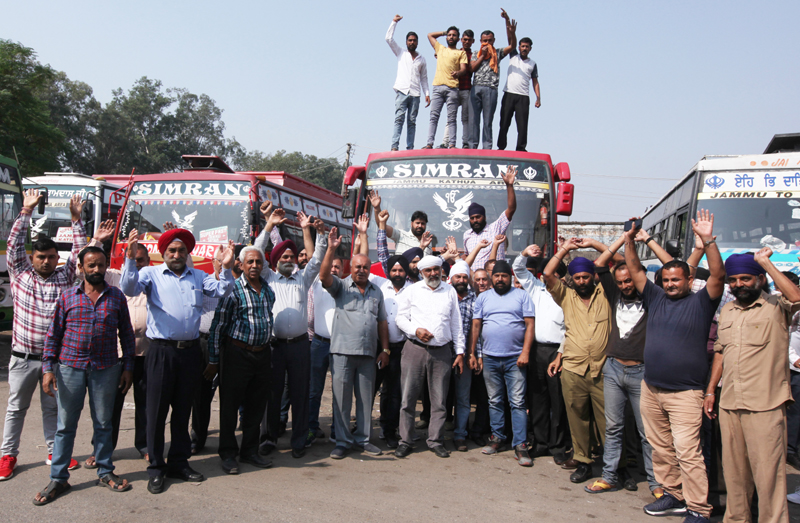 Transporters protesting at Ware House in Jammu on Monday. —Excelsior/Rakesh