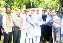 BJP MP Shamsher Singh Manhas receiving a memorandum of suggestions from Jammu Civil Society.