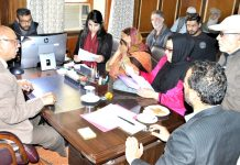 Advisor K Skandan interacting with a deputation in Srinagar on Monday.